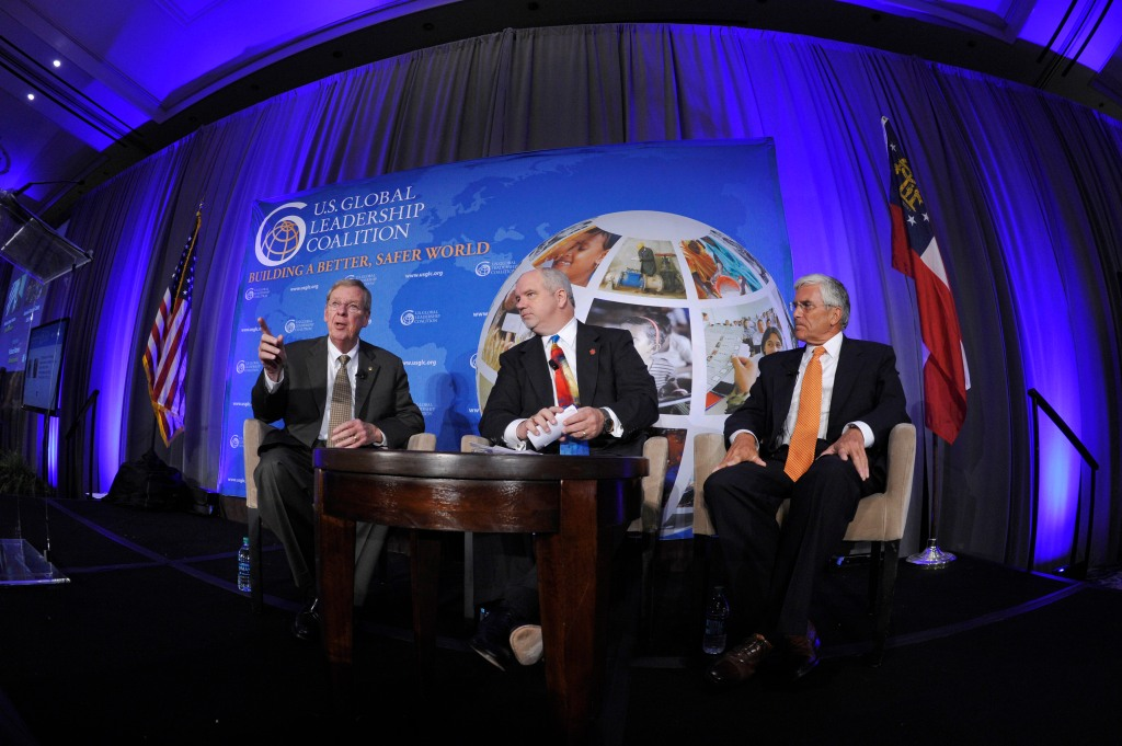 United States Senator Johnny Isakson, moderator Richard Warner and General George W. Casey